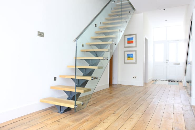 Restored flooring :  Corridor, hallway & stairs by PAD ARCHITECTS