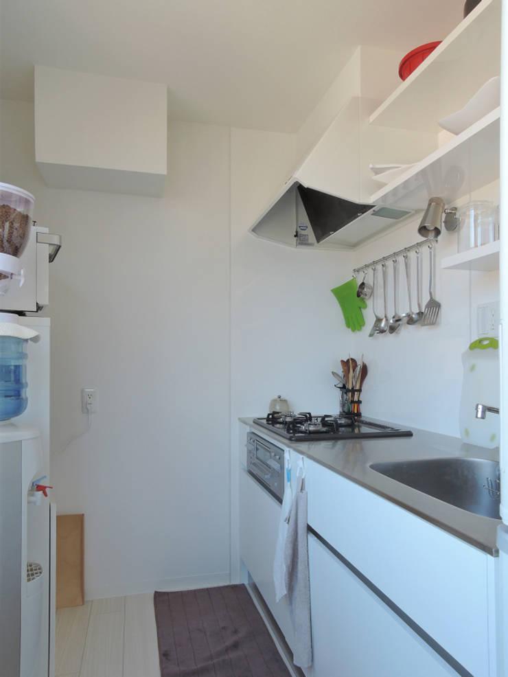 初台の家: 株式会社エキップが手掛けたキッチンです。,オリジナル