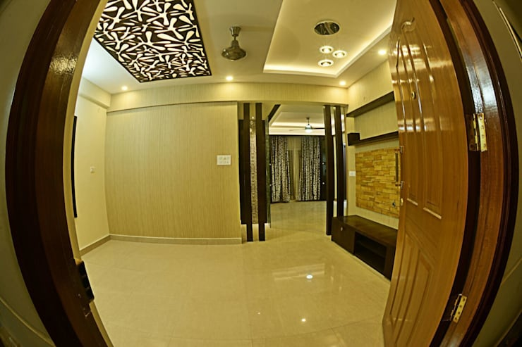 A CREATIVE AXIS INTERIORS PVT LTD PROJECT 1:  Living room by Creative Axis Interiors Pvt. Ltd.