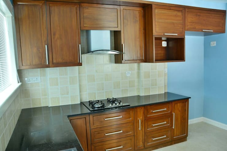 A CREATIVE AXIS INTERIORS PVT LTD PROJECT 2: colonial Kitchen by Creative Axis Interiors Pvt. Ltd.