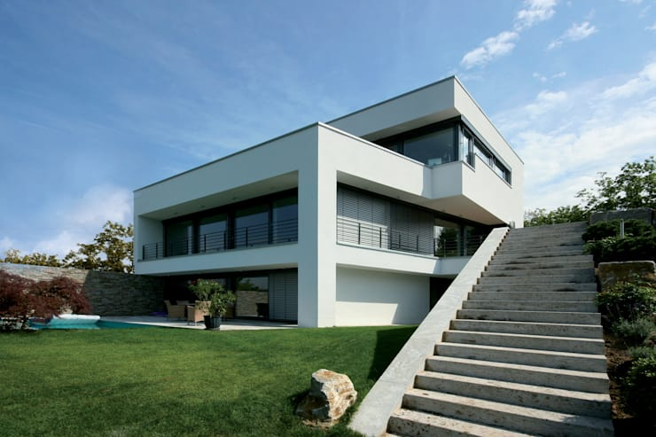 modern Houses by FLOW.Architektur