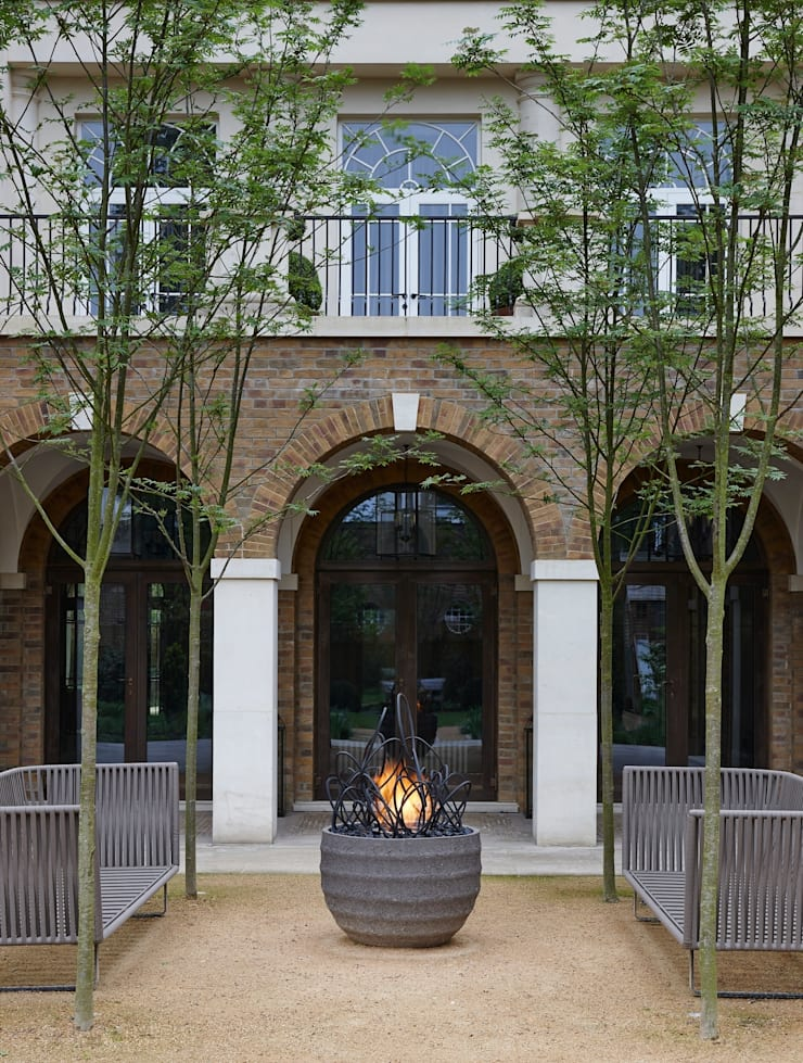 The changing face of the outdoor bonfire:  Garden  by BD Designs