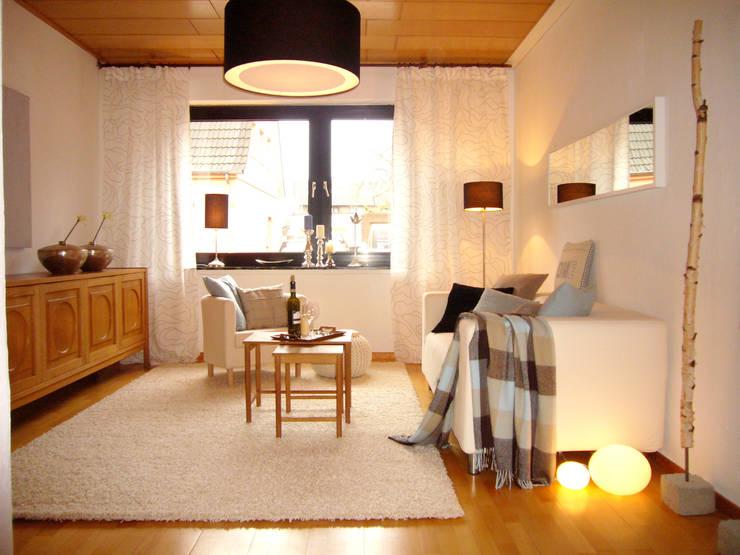 Solide Doppelhaushälfte in Selm:  Wohnzimmer von Jokiel Immobilien
