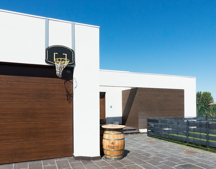 Zona de garaje: Casas de estilo  de Rubén Sánchez Albillo. Arquitecto