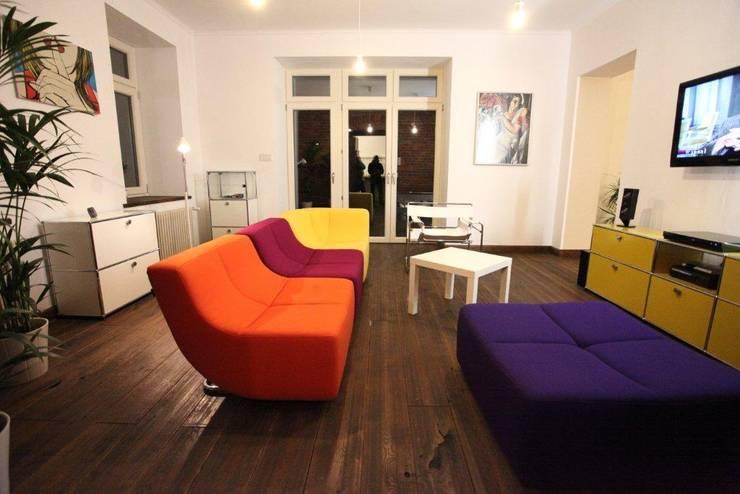 ksawery brick house: styl , w kategorii Salon zaprojektowany przez REFORM Konrad Grodziński,