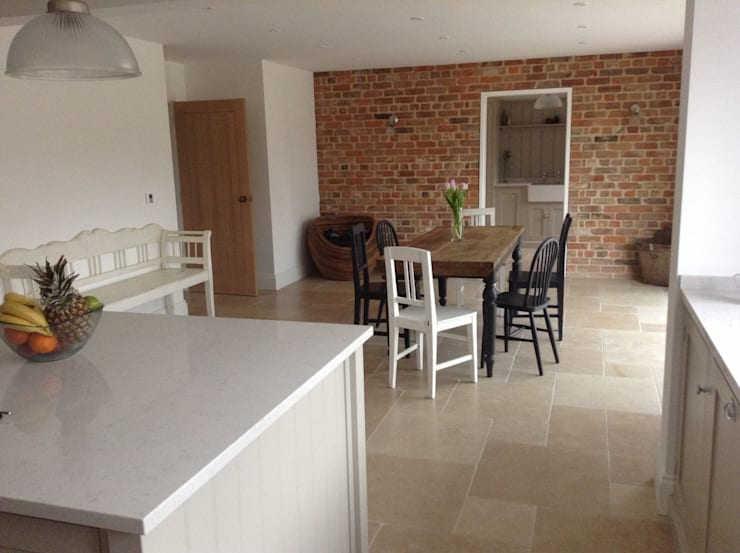 Dijon Tumbled Limestone - Kitchen/Diner:  Dining room by Floors of Stone Ltd