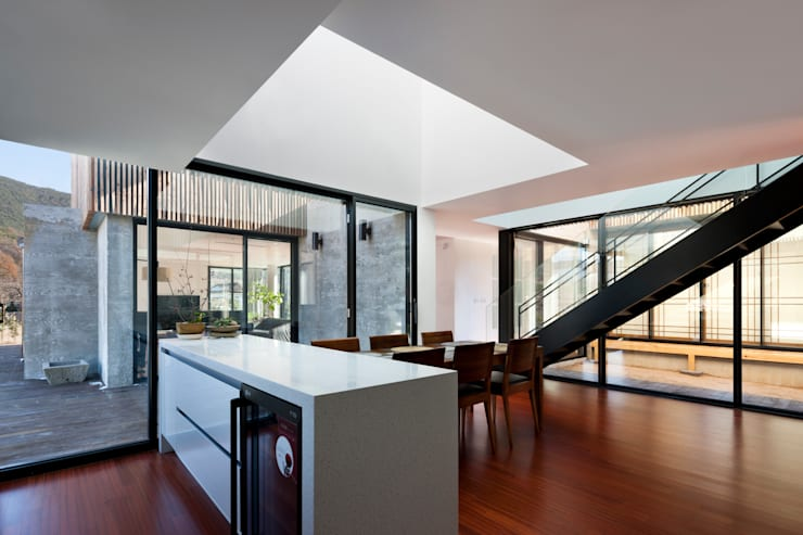 Modern dining room by ADF Architects Modern