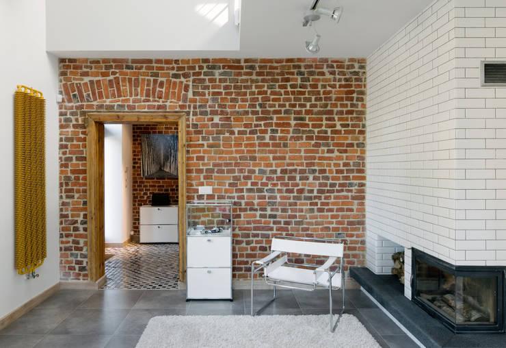 Dom Widzewska: styl , w kategorii Salon zaprojektowany przez REFORM Konrad Grodziński