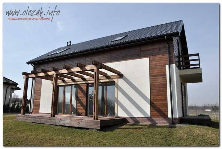 dom dwulokalowy: styl , w kategorii  zaprojektowany przez OPS Architekt Maciej Olczak