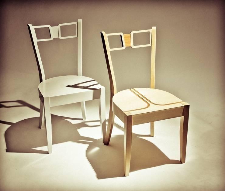 Krzesła z eleganckimi frezowaniami: styl , w kategorii Jadalnia zaprojektowany przez Marcin Skubisz Group