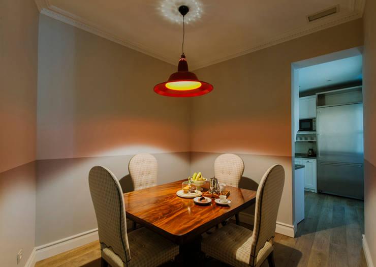 Salas de jantar  por nimú equipo de diseño