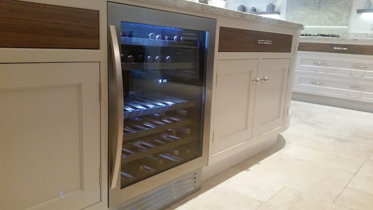 Wine chiller:  Wine cellar by Place Design Kitchens and Interiors