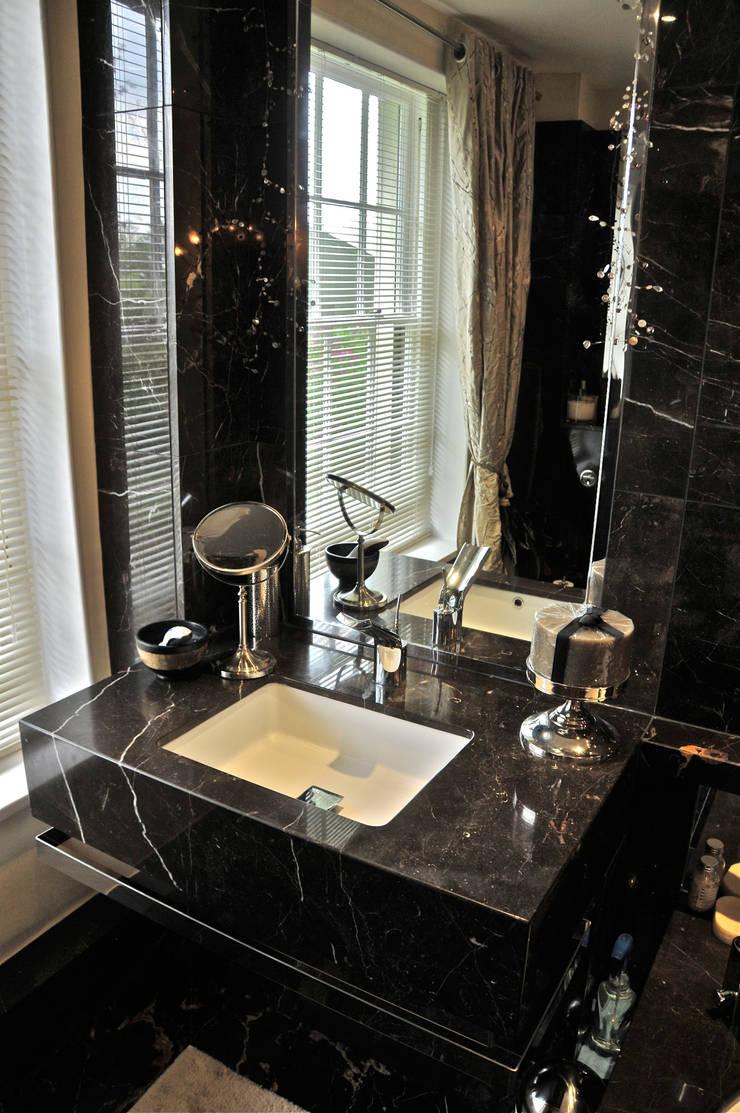 Black Marble Bathroom, Orset:  Bathroom by Ogle luxury Kitchens & Bathrooms