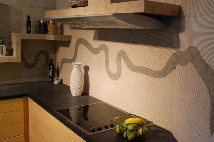 Stone feature backsplash:  Kitchen by Ogle luxury Kitchens & Bathrooms