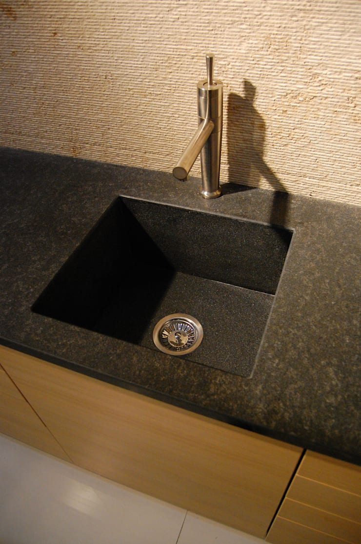 Stone sink and Backsplash:  Kitchen by Ogle luxury Kitchens & Bathrooms