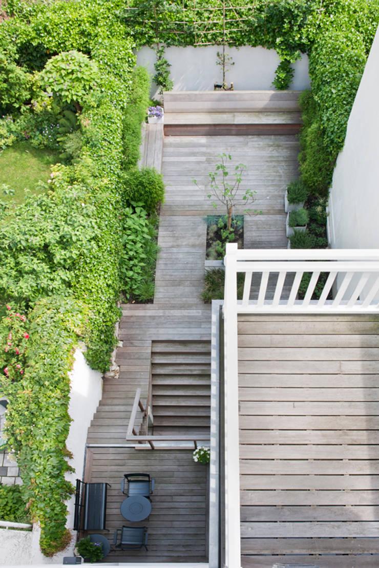 Vernieuwbouw grachtenpand:  Tuin door Kodde Architecten bna
