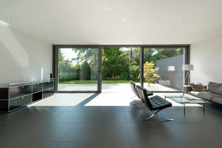 Haus C: minimalistische Wohnzimmer von K6architekten