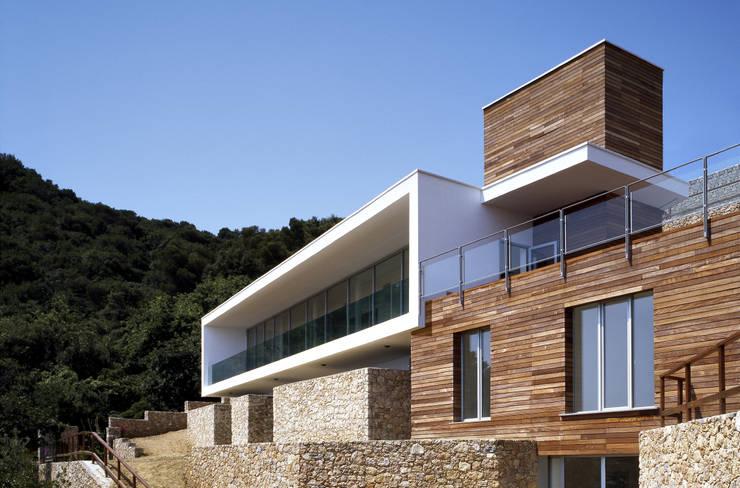 Villa T: Case in stile  di marco ciarlo associati