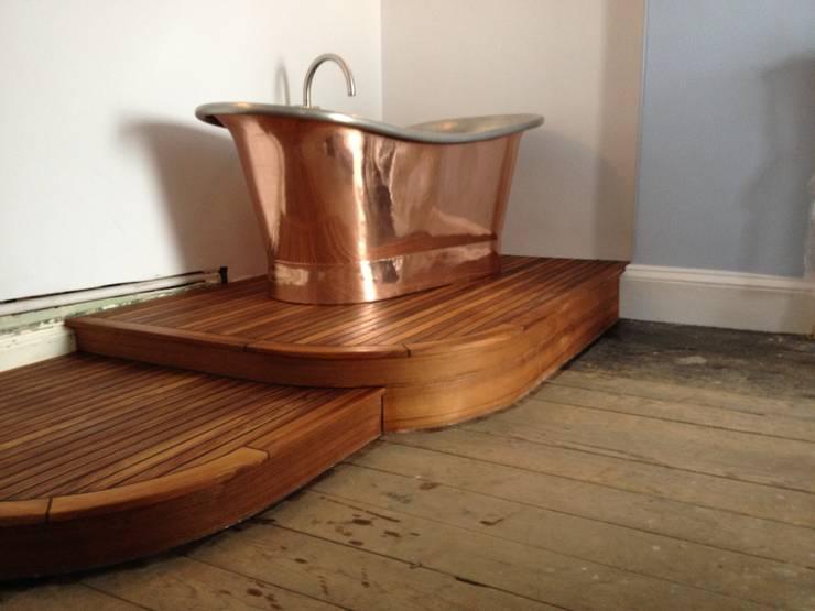 Copper bateau bath with riva teak platform design and installation in Tenby :   by Pembroke Bathrooms