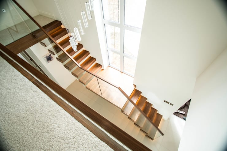 Two Levels of Floating Stairway:  Corridor, hallway & stairs by Railing London Ltd