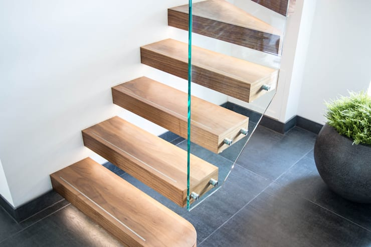 Spiral Floating Staircase with LED Illuminated Treads :  Corridor, hallway & stairs by Railing London Ltd