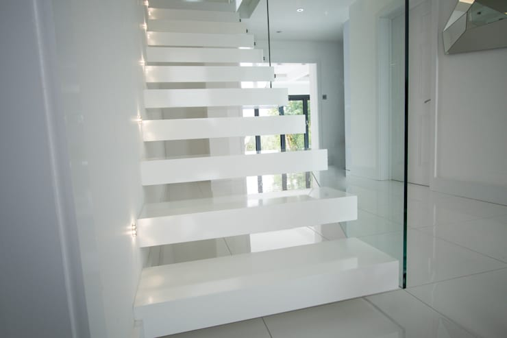 Cantilever Staircase realised in wood painted wait by