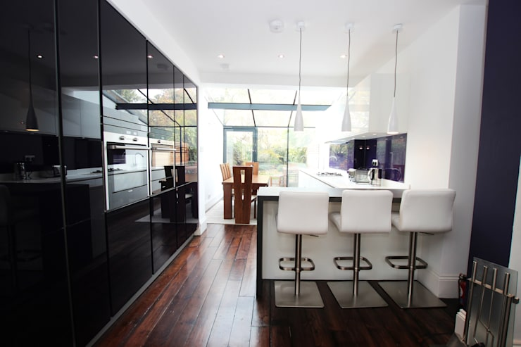 Purple gloss glass with white gloss lacquer kitchen units​:  Kitchen by LWK Kitchens