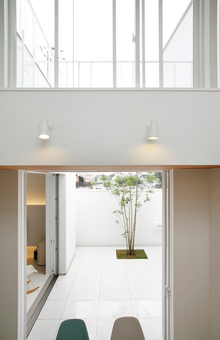 house ma: アークス建築デザイン事務所が手掛けた庭です。