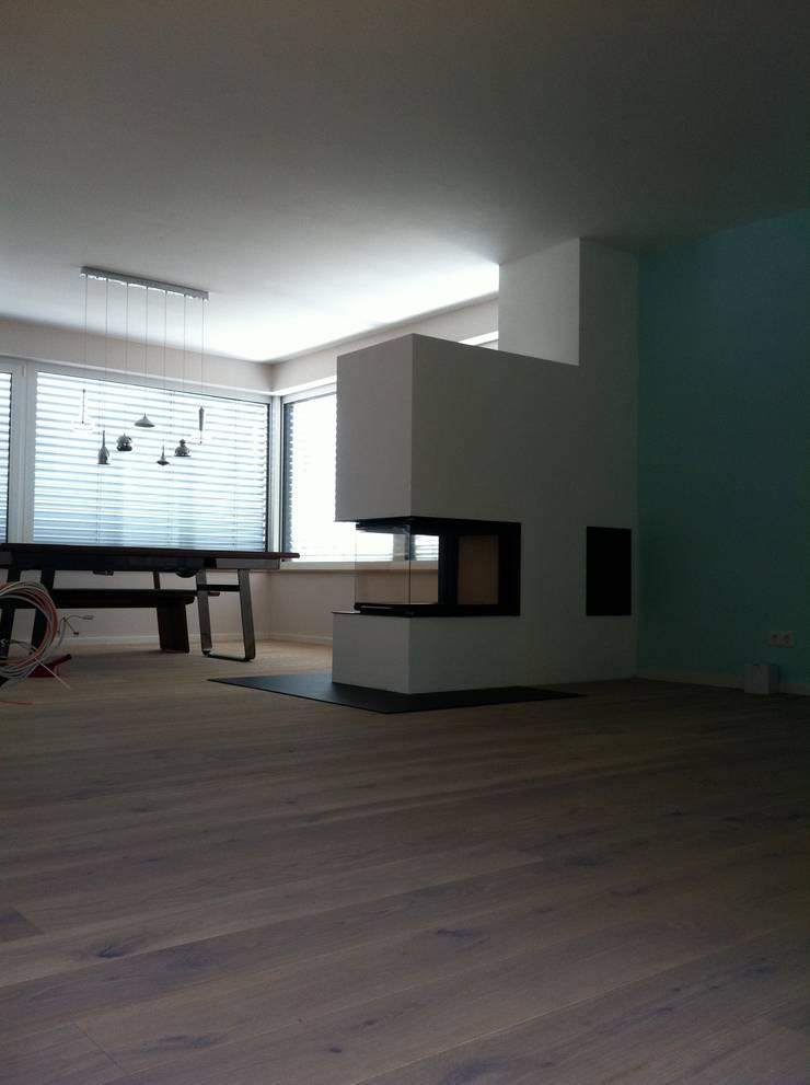 Living room by ofenmanufaktur. meisterbetrieb ,