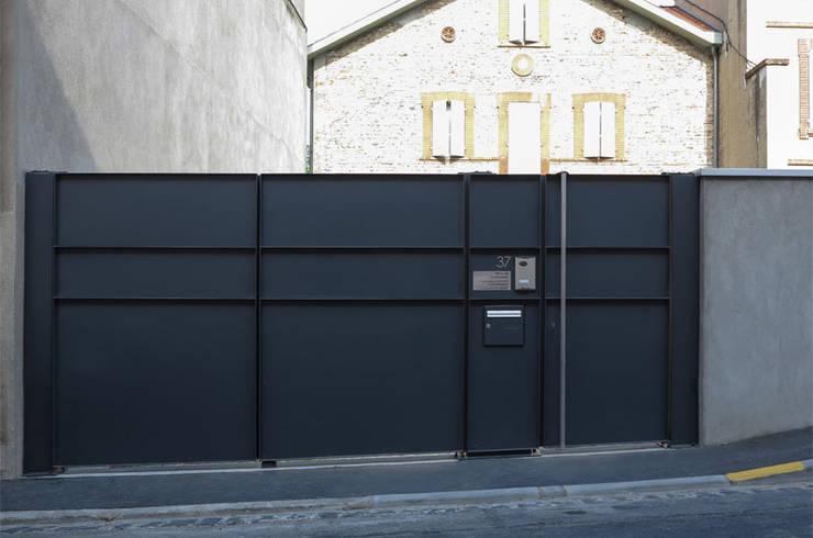 Portail CP #37: Maisons de style  par ATELIER R ARCHITECTES