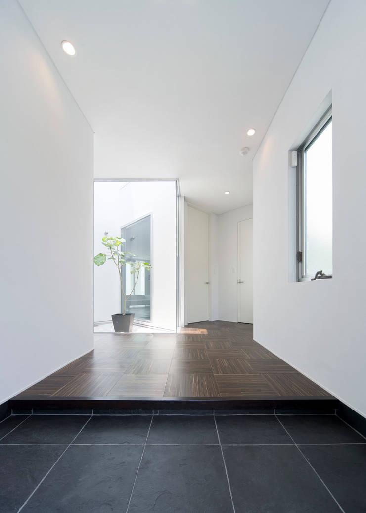 道後白水台の家: 株式会社細川建築デザインが手掛けた壁です。