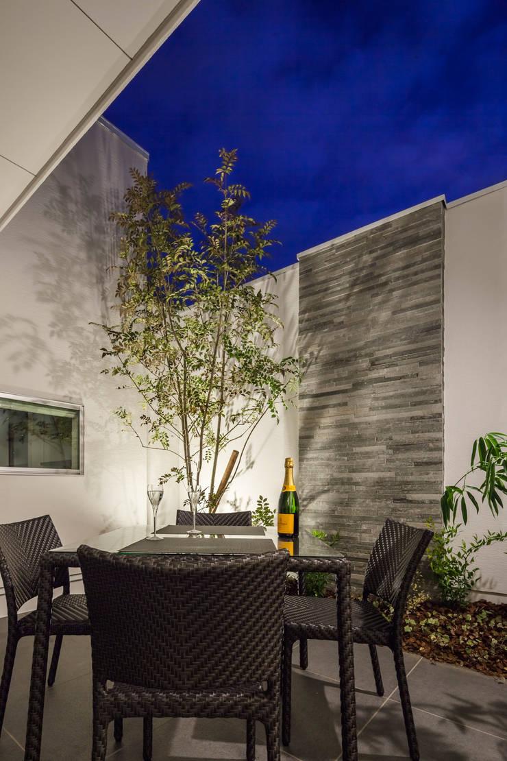 道後のコートハウス: 株式会社細川建築デザインが手掛けた庭です。