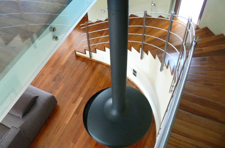 Casa M: Ingresso & Corridoio in stile  di Stefania Paradiso Architecture