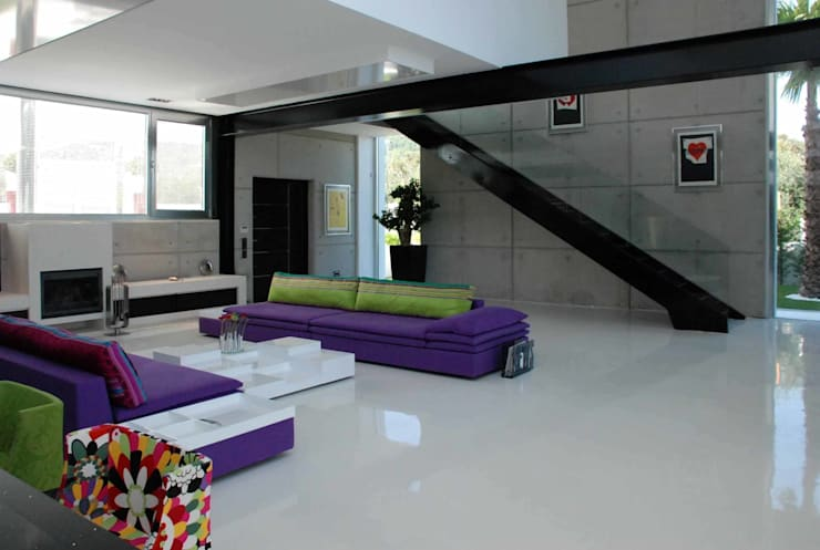 Livings de estilo  por Unlimited Design