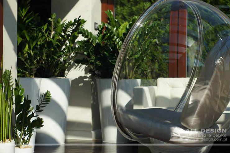 Realizacja projektu ogrodu zimowego pod Kaliszem: styl , w kategorii Ogród zimowy zaprojektowany przez All Design- Aleksandra Lepka,Nowoczesny