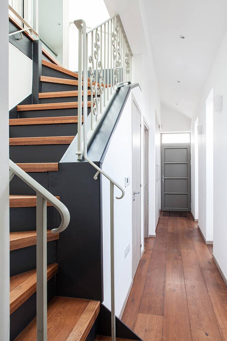 New Build House, London:  Corridor, hallway & stairs by Nic  Antony Architects Ltd