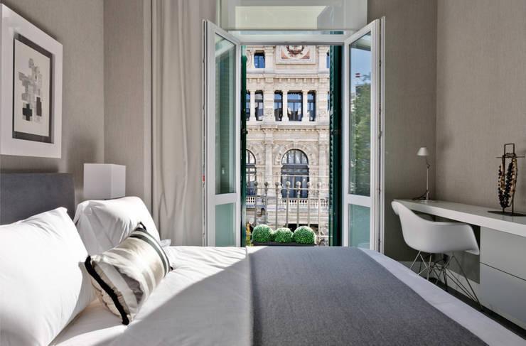 Projekty,  Sypialnia zaprojektowane przez SILVIA REGUERA INTERIORISMO