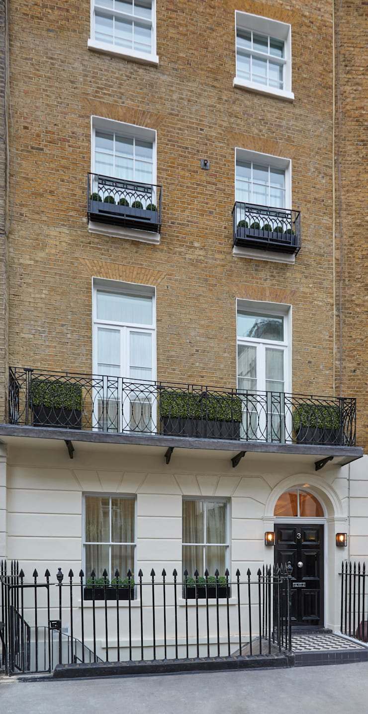 Front of Belgravia townhouse photo showing buxus hedging in planters:  Garden  by FORK Garden Design