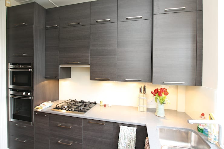 ​Small dark wood kitchen design:  Kitchen by LWK Kitchens