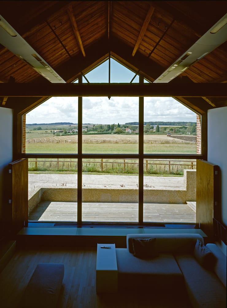 The Long Barn:  Living room by Nicolas Tye Architects