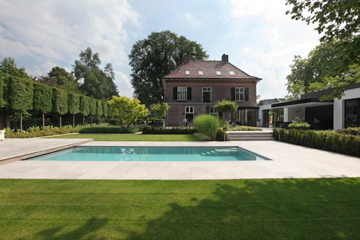 Jardines de estilo  por Stoop Tuinen