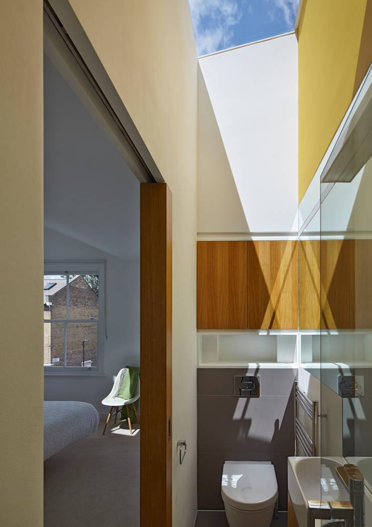 Ensuite bathroom lit by skylight:  Bathroom by Neil Dusheiko Architects