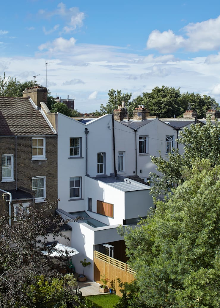 Rear view of the Islington House:  Terrace house by Neil Dusheiko Architects