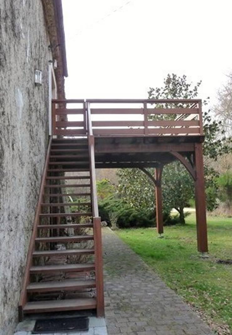 résidence secondaire : loft à la campagne: Terrasse de style  par Modularoom