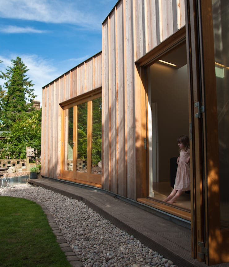 Angled rear elevation:  Houses by Neil Dusheiko Architects