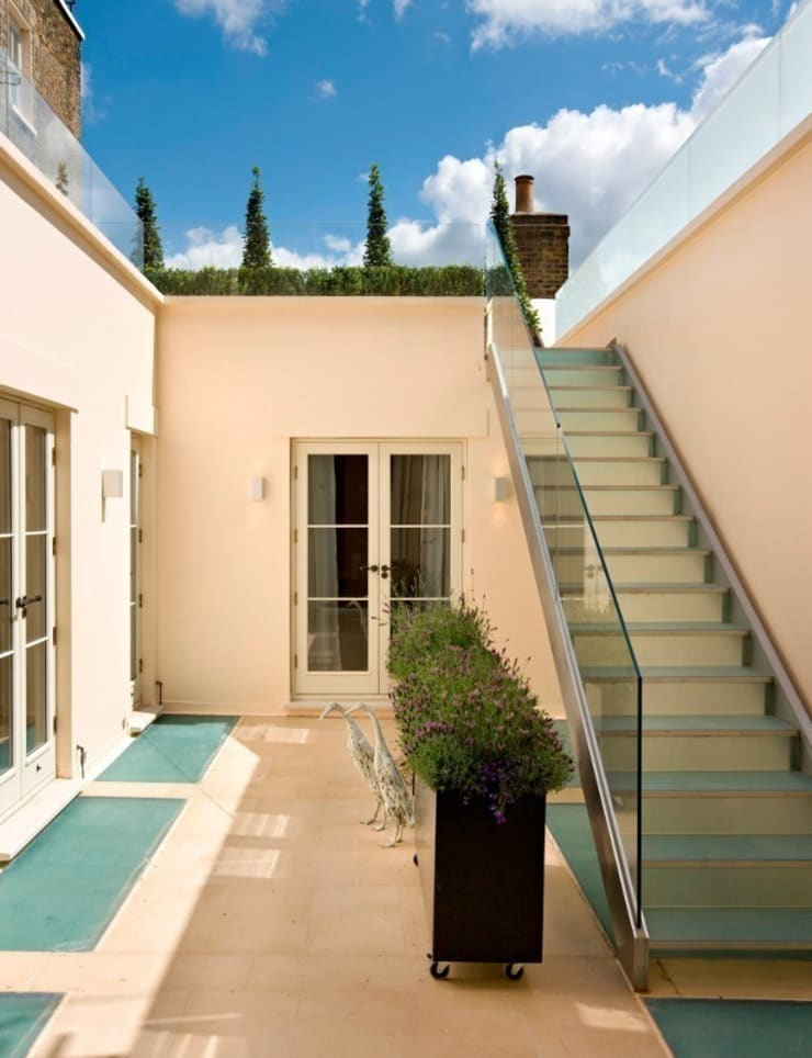 External frameless glass balustrade and mezzanine floor:  Garden by Ion Glass