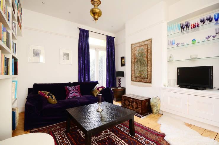 Living room TV area:  Living room by ZazuDesigns
