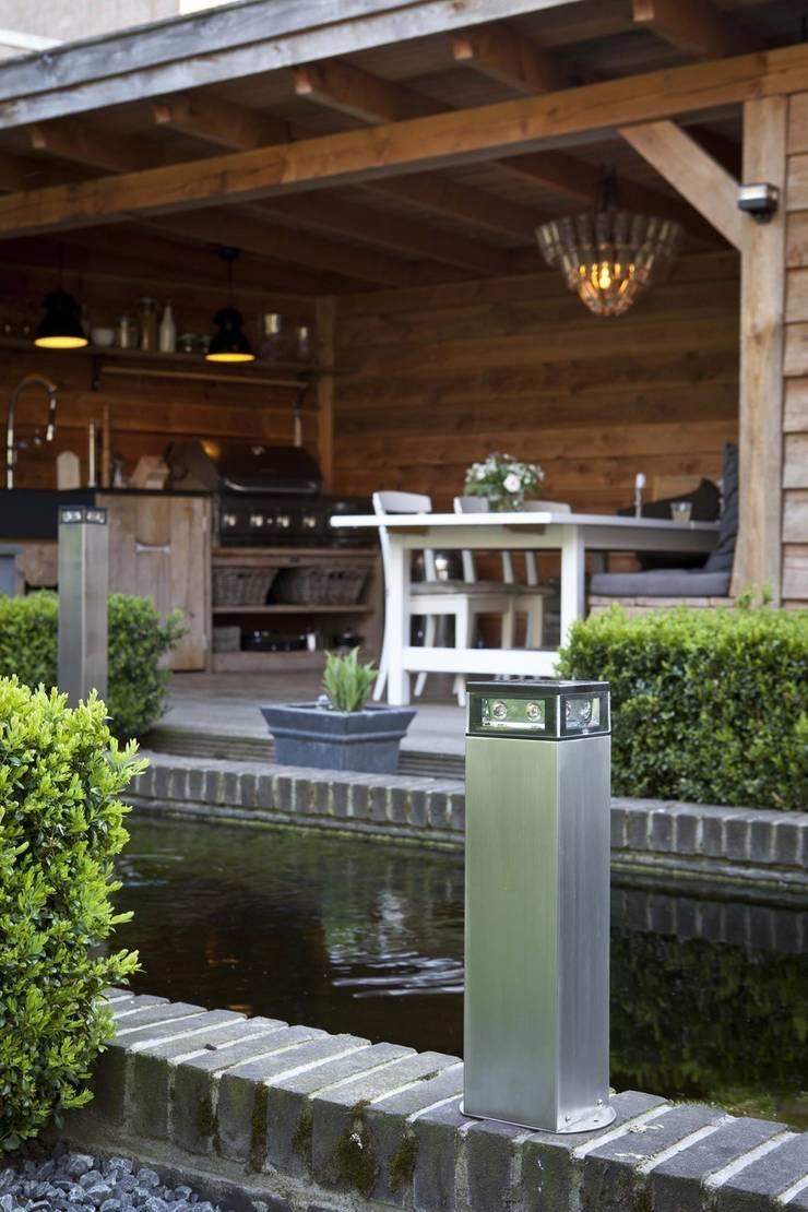 CATWALK: Jardín de estilo  de Comercial Martens