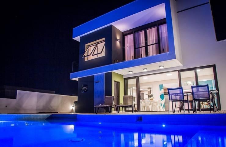 Casas de estilo  por HAUS