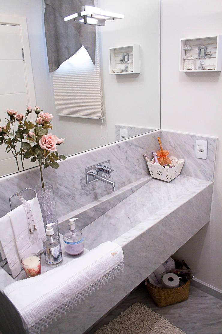 Lavabo: Banheiros modernos por HAUS